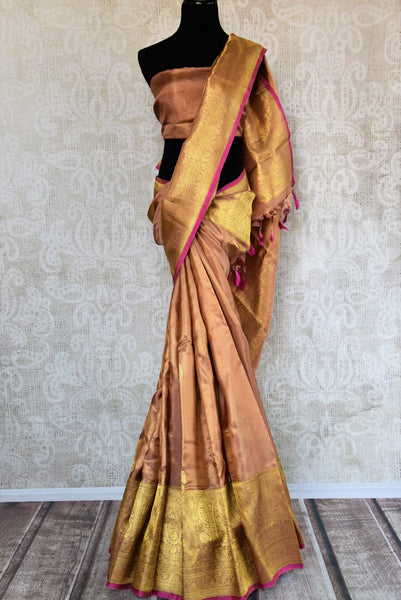 Buy golden beige Kanjivaram silk sari with zari border online in USA. Choose from a range of exquisite wedding sarees at Pure Elegance Indian clothing store in USA. -full view