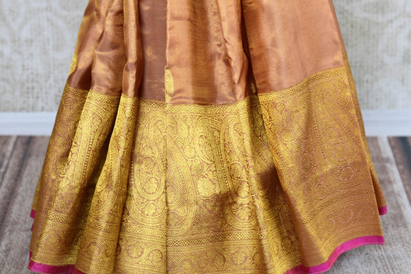Buy golden beige Kanjivaram silk sari with zari border online in USA. Choose from a range of exquisite wedding sarees at Pure Elegance Indian clothing store in USA. -pleats
