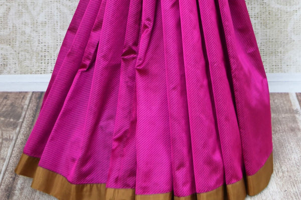 Shop magenta and green striped applique silk saree with blouse online in USA. Explore from a range of exclusive Indian silk sarees at Pure Elegance online store...-pleats