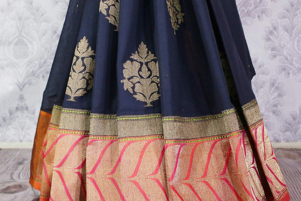 Buy navy blue linen Banarasi saree online in USA. Pure Elegance Indian clothing store brings an exclusive range of Indian Banarasi sarees for women in USA.-pleats
