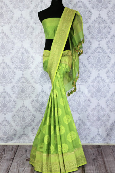 Buy beautiful green Banarasi silk saree online in USA. Exclusive collection of traditional Indian sarees at Pure Elegance Indian clothing store for women in USA. -full view