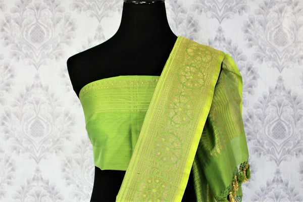 Buy beautiful green Banarasi silk saree online in USA. Exclusive collection of traditional Indian sarees at Pure Elegance Indian clothing store for women in USA. -blouse pallu