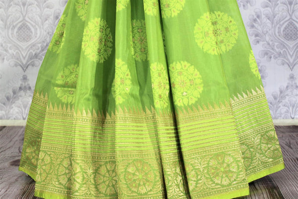 Buy beautiful green Banarasi silk saree online in USA. Exclusive collection of traditional Indian sarees at Pure Elegance Indian clothing store for women in USA. -pleats