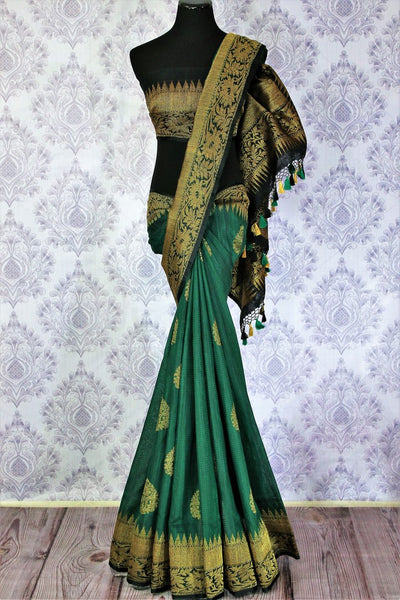 Buy ethnic bottle green Banarasi tussar saree online in USA. Exclusive collection of traditional Indian  sarees at Pure Elegance Indian clothing store for women in USA. -full view