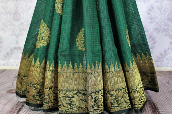 Buy ethnic bottle green Banarasi tussar saree online in USA. Exclusive collection of traditional Indian  sarees at Pure Elegance Indian clothing store for women in USA. -pleats