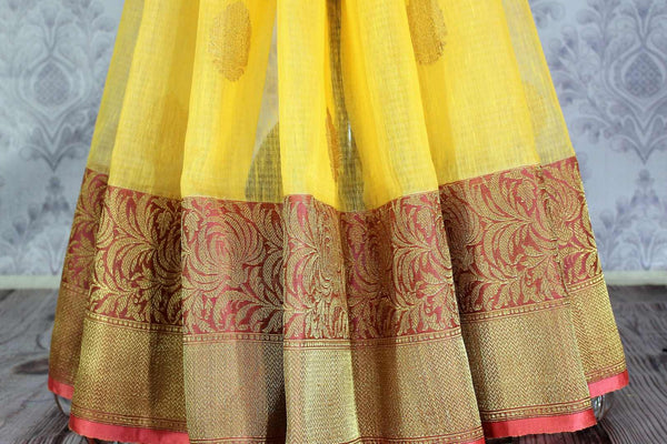 Buy yellow kora Banarasi sari online in USA with buta. Amazing collection of traditional Indian Banarasi sarees at Pure Elegance online store for women in USA. -pleats