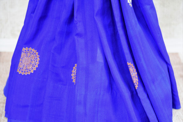 Buy blue muga silk Banarasi sari with buta online in USA. Choose from a range of traditional Indian silk saris at Pure Elegance online store or visit our store in USA.-pleats