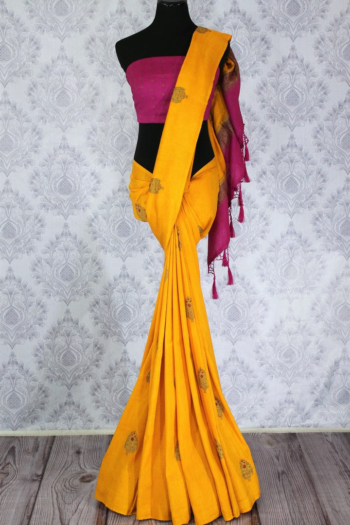 Bright yellow muga Banarasi saree with buta buy online in USA. Shop the latest design Indian designer sarees from Pure Elegance clothing store in USA for women.-full view