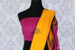 Bright yellow muga Banarasi saree with buta buy online in USA. Shop the latest design Indian designer sarees from Pure Elegance clothing store in USA for women.-blouse pallu