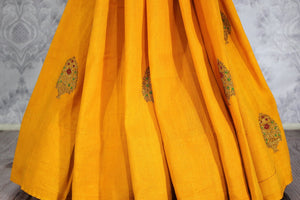 Bright yellow muga Banarasi saree with buta buy online in USA. Shop the latest design Indian designer sarees from Pure Elegance clothing store in USA for women.-pleats