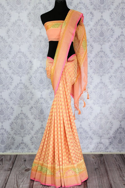 Beautiful peach color georgette Banarasi saree with zari buta buy online in USA. Explore a range of Indian designer sarees at Pure Elegance clothing store for women.-full view