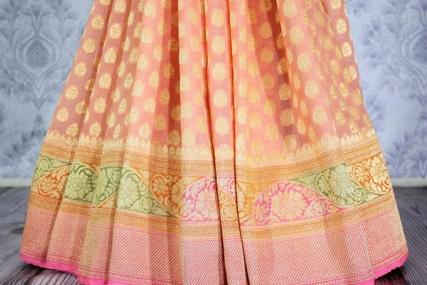 Beautiful peach color georgette Banarasi saree with zari buta buy online in USA. Explore a range of Indian designer sarees at Pure Elegance clothing store for women.-pleats