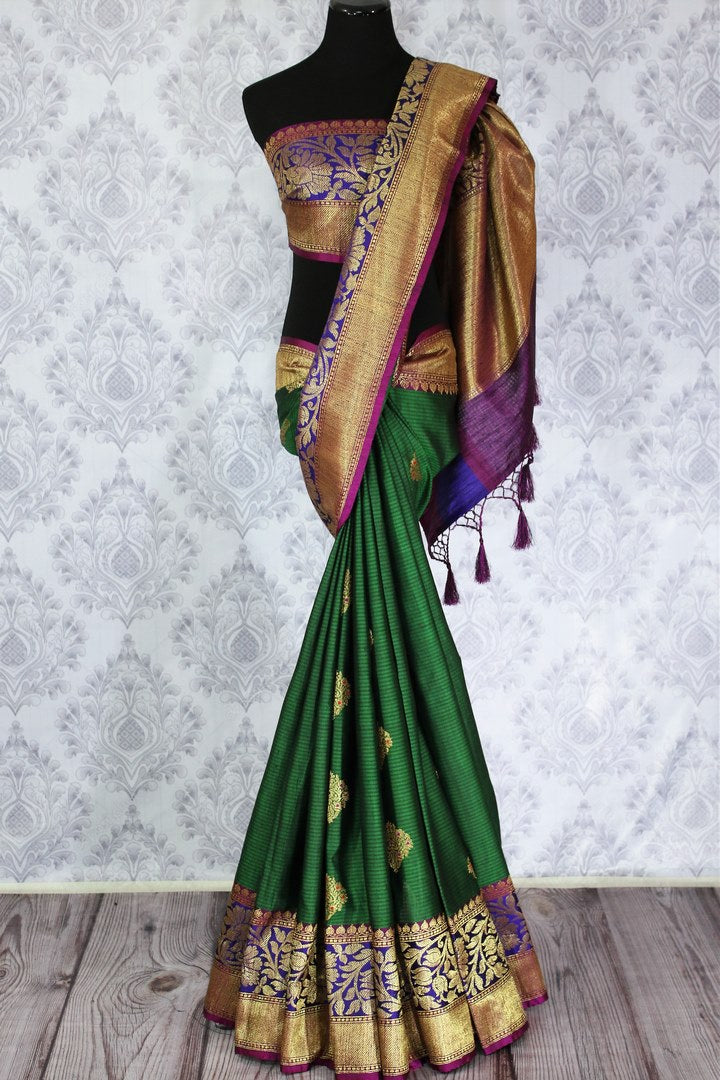 Beautiful bottle green tussar Banarasi saree with zari buta buy online in USA. Explore a range of Indian designer sarees at Pure Elegance clothing store for women.-full view