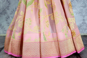 Beautiful pink color georgette Banarasi saree with floral design buy online in USA. Explore a range of Indian designer sarees at Pure Elegance clothing store for women.-pleats