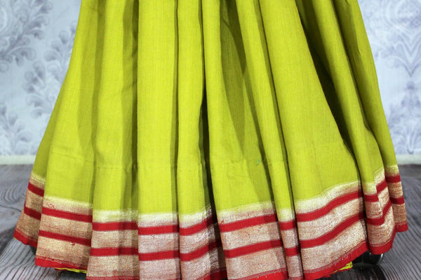 Parrot green muga Banarasi saree with red zari border buy online in USA. Explore a range of beautiful Indian Banarasi sarees at Pure Elegance clothing store for women.-pleats