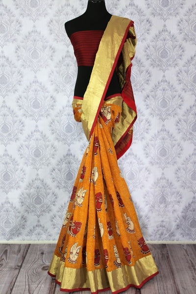 Buy bright orange chanderi silk sari online in usa with dancing hands print. The saree is adorned with a bright gold border making it a perfect occasionwear. For more such elegant Indian designer saris in USA, shop at Pure Elegance Indian clothing store or visit online.-full view