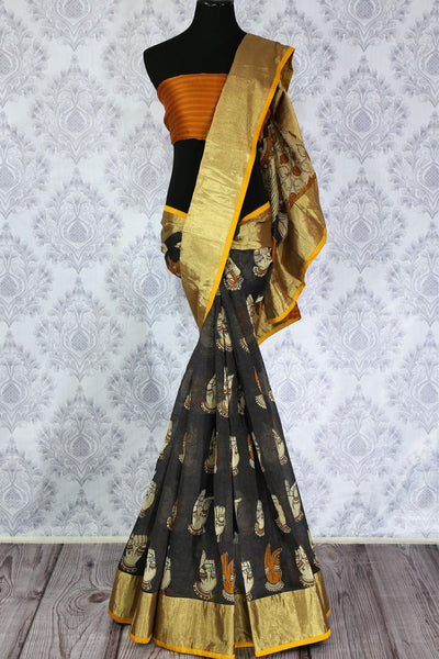 Buy greyish black chanderi silk saree online in usa with dancing hands print. The saree is adorned with a bright gold border making it perfect for an ethnic look. For more such elegant Indian designer saris in USA, shop at Pure Elegance Indian clothing store or visit online.-full view