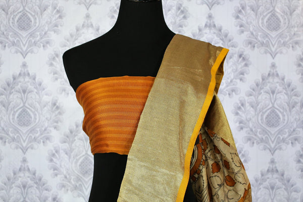 Buy greyish black chanderi silk saree online in usa with dancing hands print. The saree is adorned with a bright gold border making it perfect for an ethnic look. For more such elegant Indian designer saris in USA, shop at Pure Elegance Indian clothing store or visit online.-blouse pallu