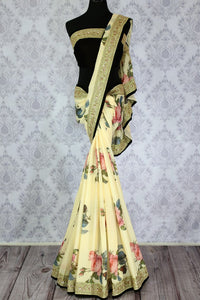 Buy cream tussar georgette printed sari online in usa with embroidered border. The designer saree is a stunning pick for parties and special occasions. For more such elegant Indian embroidered sarees in USA, shop at Pure Elegance Indian fashion store or visit online.-full view