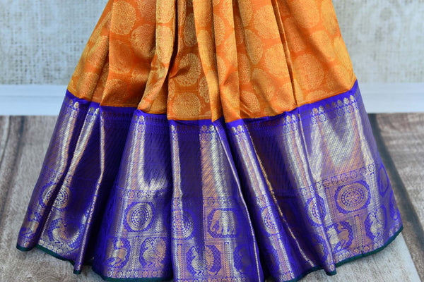 Orange Kanchipuram silk sari with blue zari border for online shopping in USA. Beautiful collection of Indian Kanjivaram sarees at Pure Elegance online store in USA.-pleats