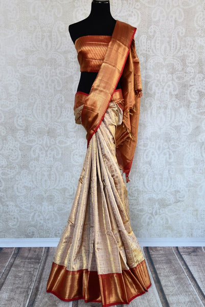 Beige gold Kanjivaram silk saree with zari border for online shopping in USA. Beautiful collection of Indian Kanjeevaram silk saris at Pure Elegance online store in USA.-full view
