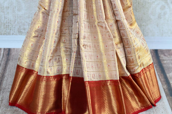 Beige gold Kanjivaram silk saree with zari border for online shopping in USA. Beautiful collection of Indian Kanjeevaram silk saris at Pure Elegance online store in USA.-pleats