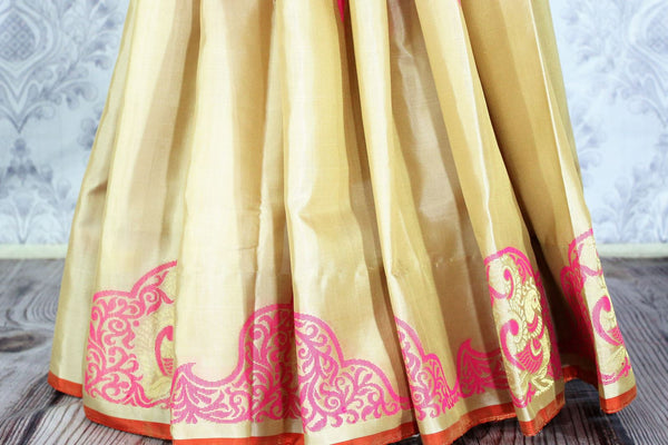 Buy cream color Kanjivaram silk saree with pink floral design online in USA. Elevate your Indian ethnic style with traditional Indian Kanchipuram sarees at Pure Elegance Clothing Store in USA, perfect for weddings and parties.-pleats