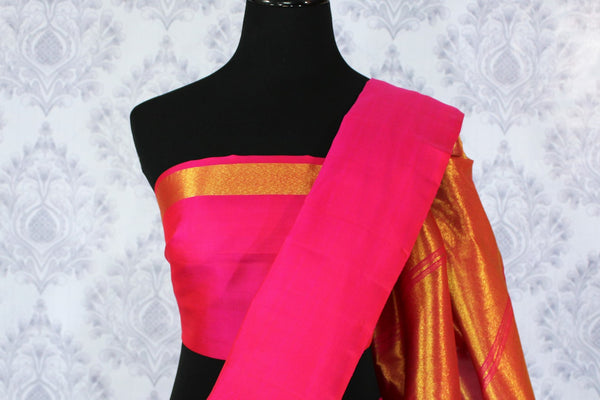 Buy bright pink Kanjivaram silk sari with golden zari pallu online in USA. Dazzle in the brilliance of traditional Indian Kanchipuram silk saris at Pure Elegance Clothing Store in USA, perfect for weddings and parties.-blouse pallu