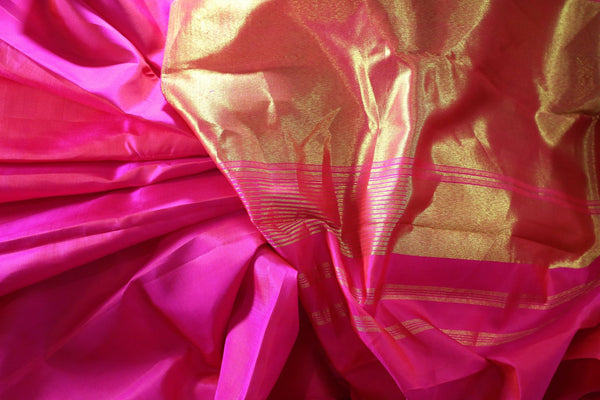 Buy bright pink Kanjivaram silk sari with golden zari pallu online in USA. Dazzle in the brilliance of traditional Indian Kanchipuram silk saris at Pure Elegance Clothing Store in USA, perfect for weddings and parties.-details