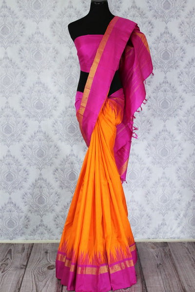 Beautiful orange Kanjivaram silk saree with pink temple border buy online in USA. Immerse in the richness of traditional Indian Kanjeevaram silk sarees at Pure Elegance Clothing Store in USA, perfect for weddings and parties.-full view