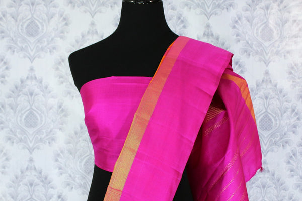 Beautiful orange Kanjivaram silk saree with pink temple border buy online in USA. Immerse in the richness of traditional Indian Kanjeevaram silk sarees at Pure Elegance Clothing Store in USA, perfect for weddings and parties.-blouse pallu
