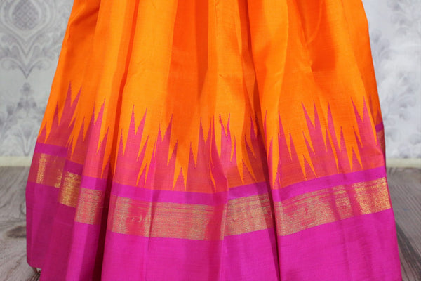 Beautiful orange Kanjivaram silk saree with pink temple border buy online in USA. Immerse in the richness of traditional Indian Kanjeevaram silk sarees at Pure Elegance Clothing Store in USA, perfect for weddings and parties.-pleats
