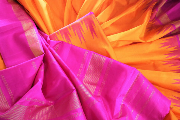 Beautiful orange Kanjivaram silk saree with pink temple border buy online in USA. Immerse in the richness of traditional Indian Kanjeevaram silk sarees at Pure Elegance Clothing Store in USA, perfect for weddings and parties.-details