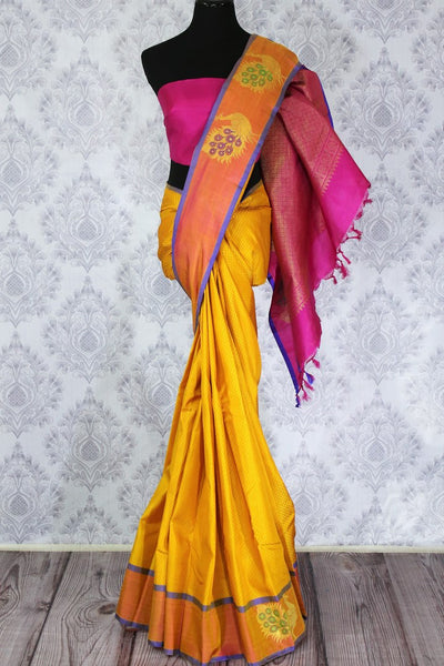 Beautiful yellow Kanchipuram silk sari with orange peacock buta border buy online in USA. Make your ethnic wardrobe rich with a range of Indian Kanjivaram sarees at Pure Elegance Clothing Store in USA, perfect for weddings and special occasions.-full view