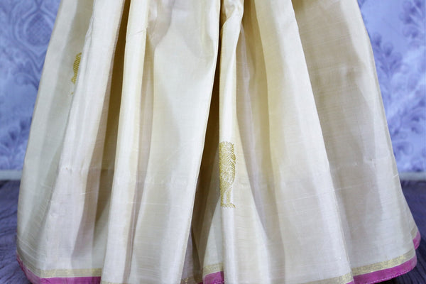 Elegant cream Kanchipuram silk sari with lion zari buta buy online in USA. Make tasteful choices with a range of Indian Kanjeevaram sarees at Pure Elegance Clothing Store in USA, perfect for weddings and special occasions.-details