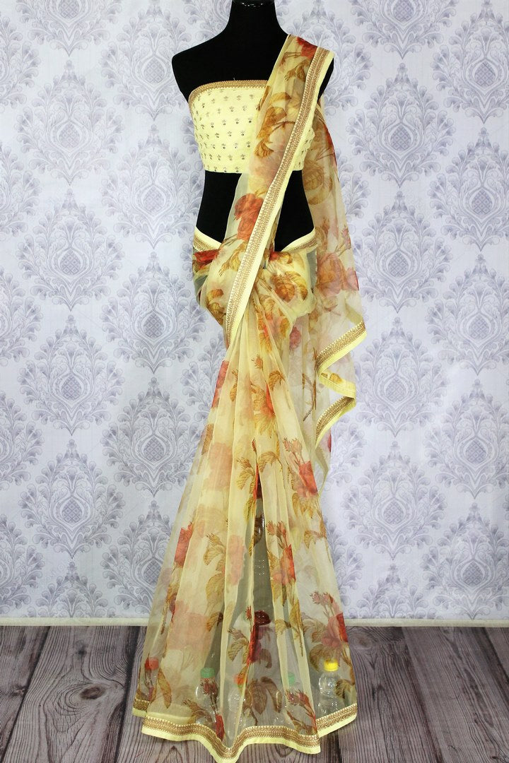 Buy elegant lemon yellow floral print organza sari online in USA.  Pure Elegance Indian fashion store brings an exquisite collection of handloom sarees in USA for parties and special occasions. Turn heads with stunning Indian saris available online and our store in USA.-full view