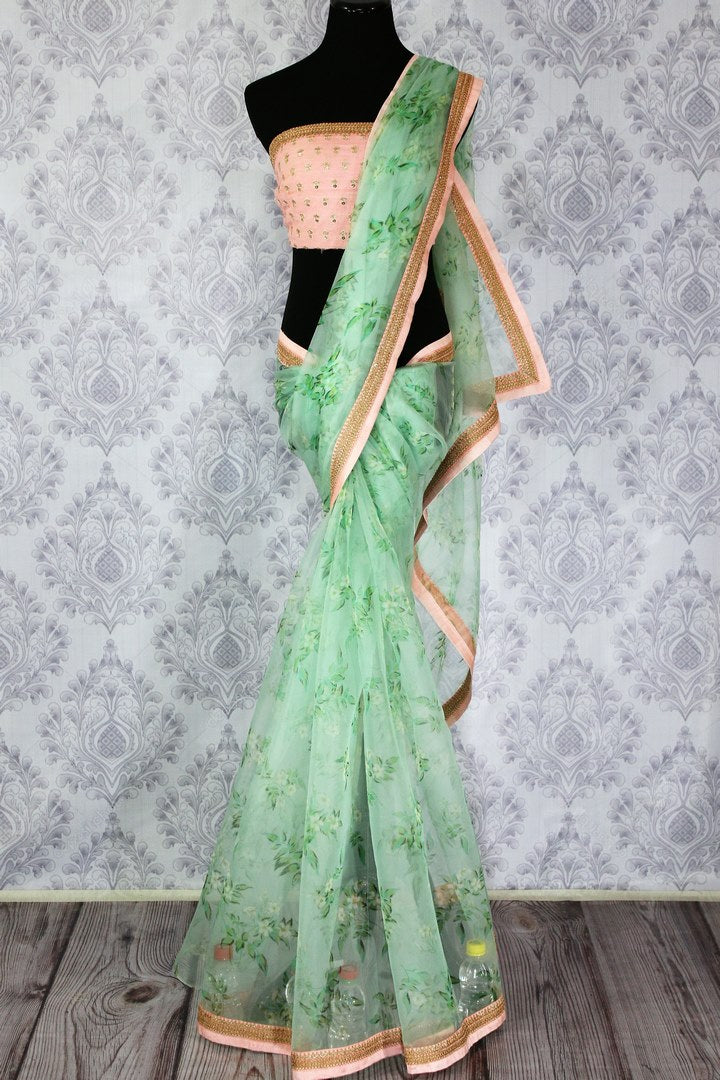 Buy beautiful pastel green floral print organza sari online in USA.  Pure Elegance Indian fashion store brings an exquisite collection of handloom sarees in USA for parties and special occasions. Turn heads with stunning Indian sarees available online and our store in USA.-full view
