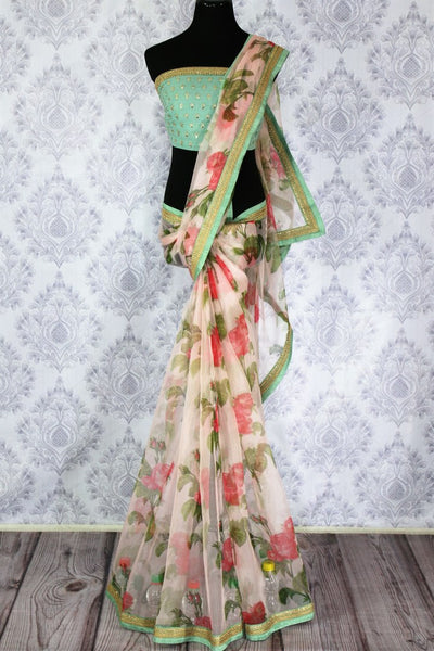 Buy beautiful pink floral print organza saree online in USA.  Pure Elegance Indian Clothing store brings an exquisite collection of handloom sarees in USA for parties and special occasions. Turn heads with stunning Indian sarees available online and our fashion store in USA.-full view