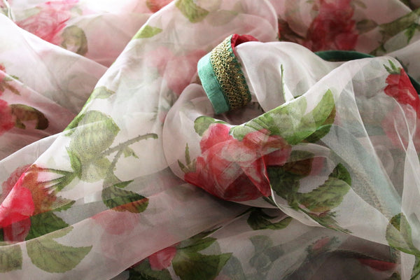 Buy beautiful pink floral print organza saree online in USA.  Pure Elegance Indian Clothing store brings an exquisite collection of handloom sarees in USA for parties and special occasions. Turn heads with stunning Indian sarees available online and our fashion store in USA.-details
