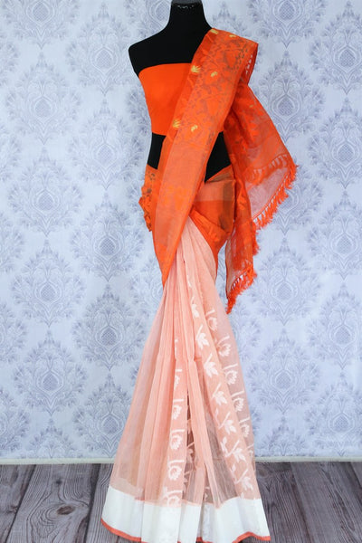 Buy online orange and peach Dhakai jamdani sari in USA. The saree is decorated with fine woven floral motifs perfect for an elegant Indian look. Shop beautiful Indian handloom sarees in USA at Pure Elegance fashion store for women.-full view