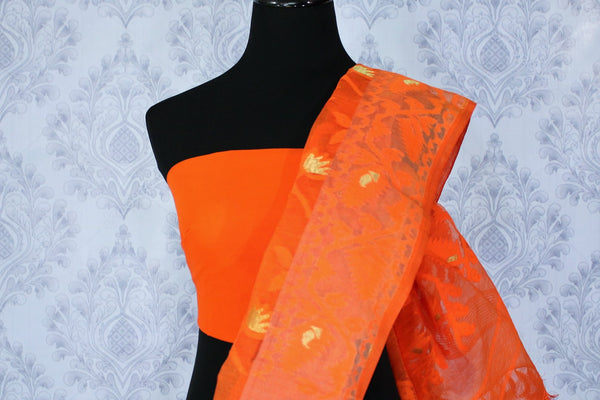 Buy online orange and peach Dhakai jamdani sari in USA. The saree is decorated with fine woven floral motifs perfect for an elegant Indian look. Shop beautiful Indian handloom sarees in USA at Pure Elegance fashion store for women.-blouse pallu