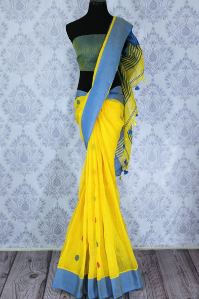 Buy online ethnic yellow linen saree in USA. The saree is contrasted with yellow border and pallu and bright pink butas which makes it so striking. Shop beautiful Indian handloom saris in USA at Pure Elegance fashion store for a beautiful Indian saree look.-full view