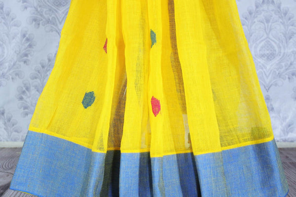 Buy online ethnic yellow linen saree in USA. The saree is contrasted with yellow border and pallu and bright pink butas which makes it so striking. Shop beautiful Indian handloom saris in USA at Pure Elegance fashion store for a beautiful Indian saree look.-pleats