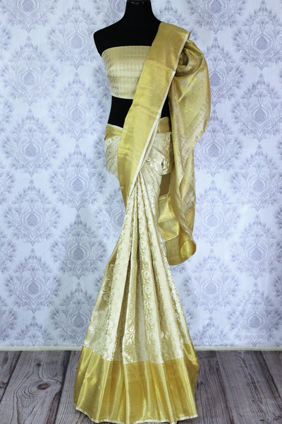 Buy traditional cream Kanchipuram silk saree online in USA. The saree is beautifully handcrafted with pure zari work and floral design. Shop beautiful Indian wedding sarees in USA at Pure Elegance fashion store for a stunning traditional look.-full view