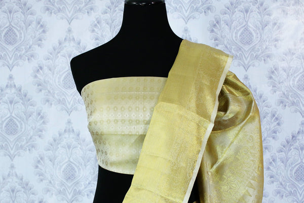 Buy traditional cream Kanchipuram silk saree online in USA. The saree is beautifully handcrafted with pure zari work and floral design. Shop beautiful Indian wedding sarees in USA at Pure Elegance fashion store for a stunning traditional look.-blouse pallu