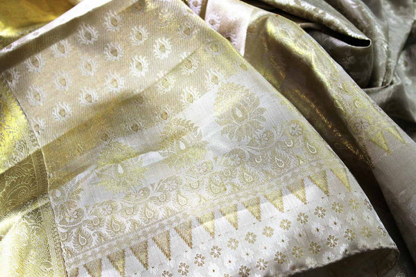 Buy traditional cream Kanchipuram silk saree online in USA. The saree is beautifully handcrafted with pure zari work and floral design. Shop beautiful Indian wedding sarees in USA at Pure Elegance fashion store for a stunning traditional look.-details