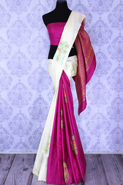 Buy beautiful off white and magenta Kanjivaram silk sari online in USA. The saree is richly decorated with zari pallu and elaborate chariots motifs. For more such beautiful Indian Kanjeevaram silk sarees in USA shop at Pure Elegance clothing store for a stunning traditional look.-full view