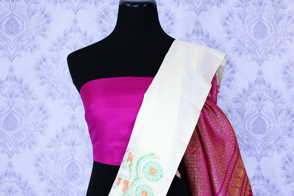 Buy beautiful off white and magenta Kanjivaram silk sari online in USA. The saree is richly decorated with zari pallu and elaborate chariots motifs. For more such beautiful Indian Kanjeevaram silk sarees in USA shop at Pure Elegance clothing store for a stunning traditional look.-blouse pallu