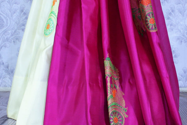 Buy beautiful off white and magenta Kanjivaram silk sari online in USA. The saree is richly decorated with zari pallu and elaborate chariots motifs. For more such beautiful Indian Kanjeevaram silk sarees in USA shop at Pure Elegance clothing store for a stunning traditional look.-pleats
