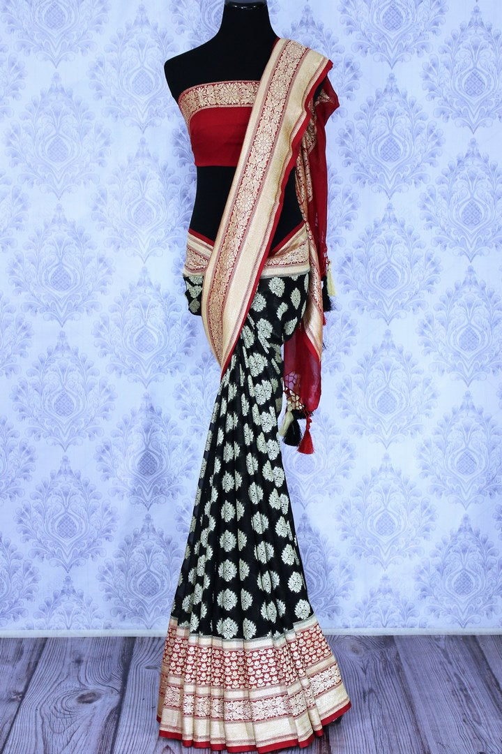 Buy beautiful black georgette Banarasi sari online in USA. The alluring design of the saree with red zari border and buta makes it perfect for parties and festivals. Select from an exquisite collection of traditional Indian Banarasi sarees, designer sarees at Pure Elegance clothing store or shop online for weddings.-full view